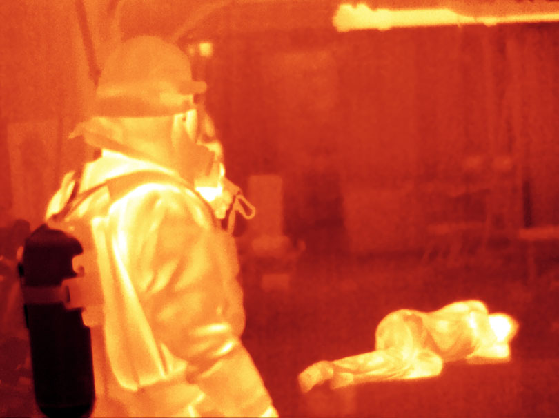 As each slider bar is manipulated, the view transitions from visible light to infrared light. In visible light: In thick smoke, it may be impossible to see even nearby victims. In infrared light: An unconscious fire victim glows brightly in infrared light.