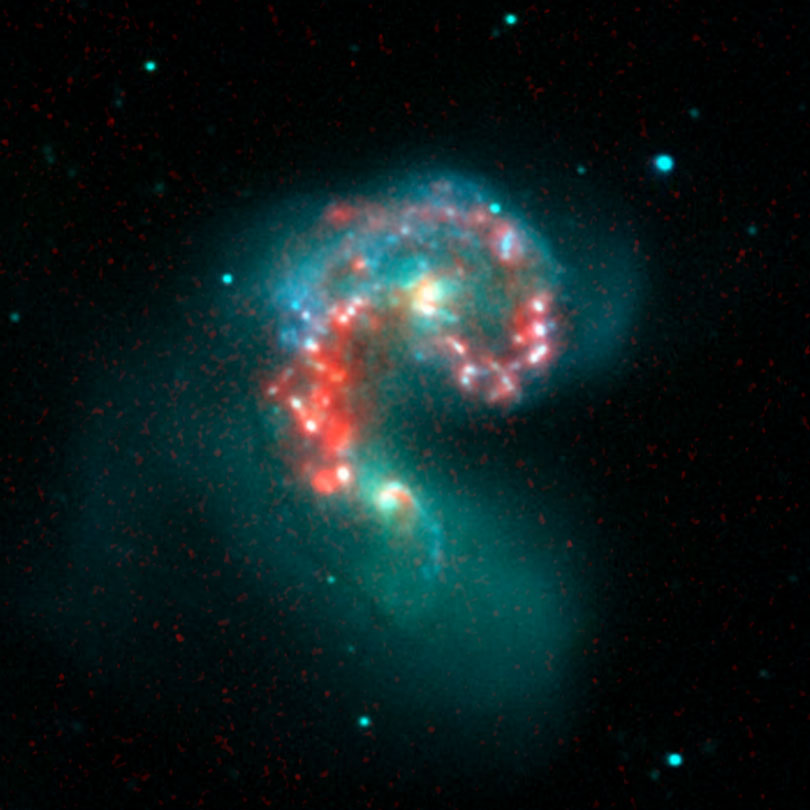 As each slider bar is manipulated, the view transitions from visible light to infrared light. In visible light: These two galaxies have been merging for 800 million years. In infrared light: The addition of infrared highlights dusty regions where stars are forming.