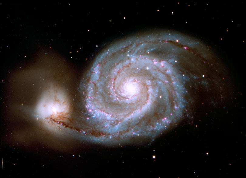 As each slider bar is manipulated, the view transitions from visible light to infrared light. In visible light: The Whirlpool Galaxy is a spiral interacting with a small companion. In infrared light: The dusty spokes in M51 are easily seen in infrared light.