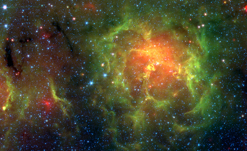 As each slider bar is manipulated, the view transitions from visible light to mid infrared light. In visible light: The Trifid Nebula glows in visible light. In mid infrared light: Deeper in the infrared, the warmest dust begins to glow red.